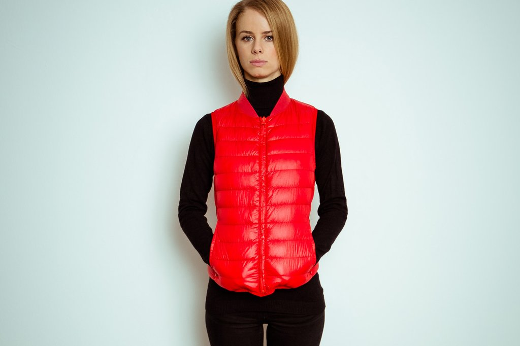 Giulia wearing the signal red goose down liner vest