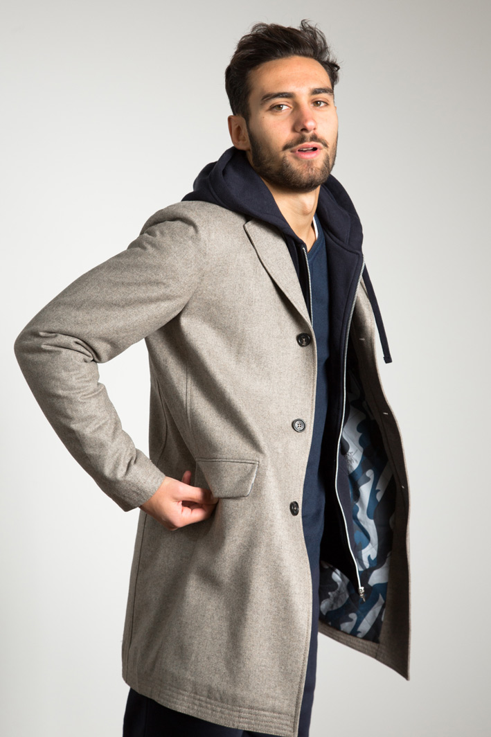 Manu wearing the w'lfg'ng water repellent wool Covert Coat made from Austrian Loden Wool