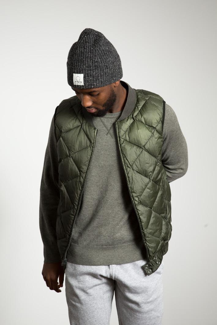 Peet wearing the w'lfg'ng goose down padded liner vest