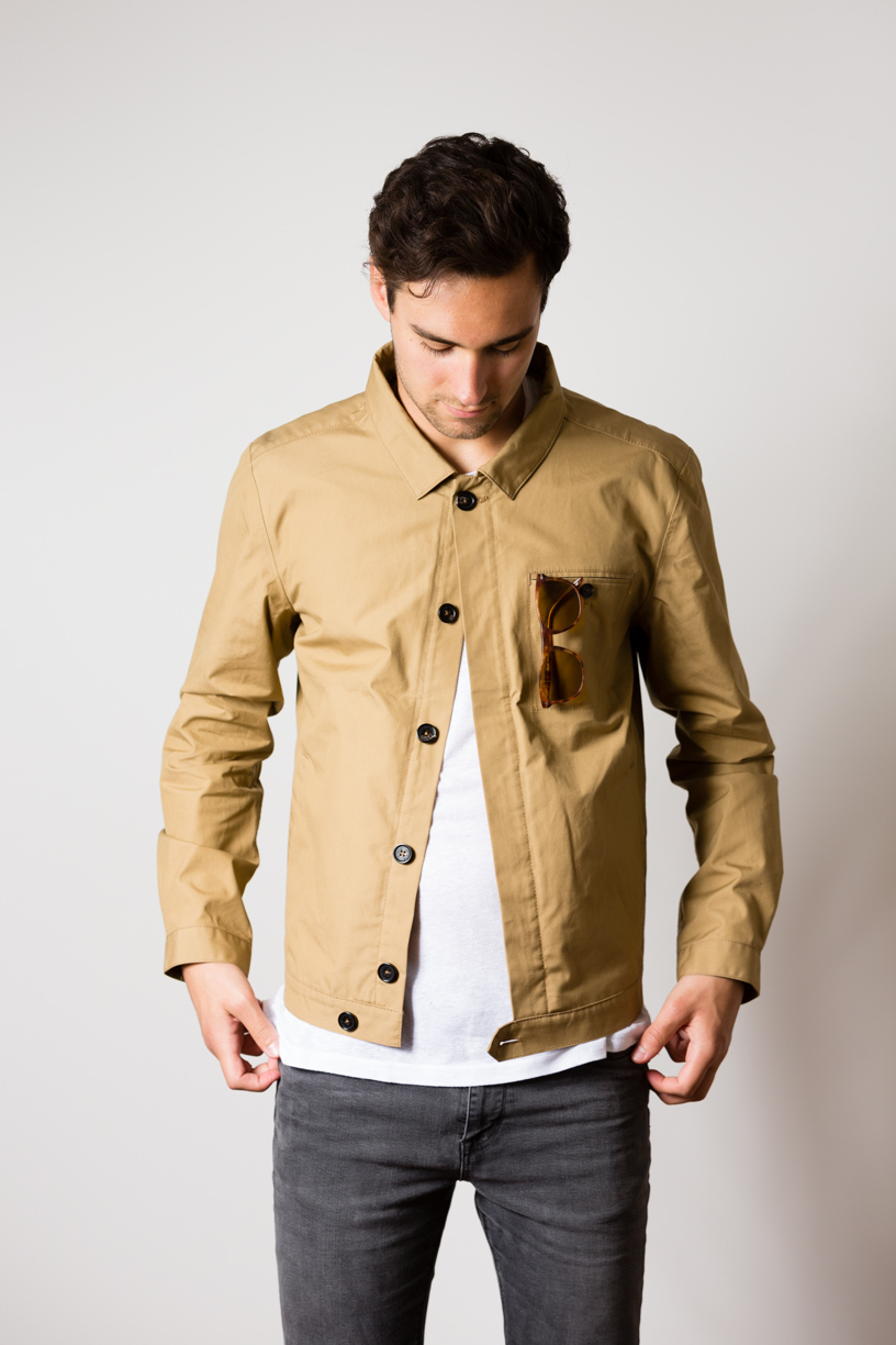 Manu wearing the w'lfg'ng British Millerain Worker Jacket in colour sand